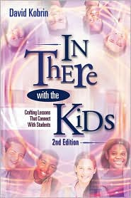 black title text in center, with images of children's faces surrounding the text, cover of in there with the kids