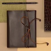 Product Image. Title: Brown Leather Wrap Traveler's Journal
